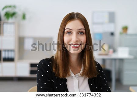 confident beautiful young businesswoman smiling at camera - stock photo