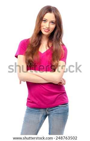 Confident beauty. Beautiful young woman looking at camera and keeping arms crossed while standing isolated on white. - stock photo