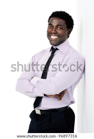 confident black african businessman leaning isolated on white with a happy smile