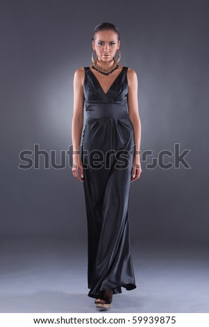 Confident brunette woman in style of Cleopatra going to the camera - stock photo