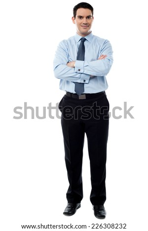 Confident business executive with folded arms  - stock photo