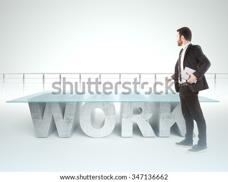 Confident business man standing near a WORK table - stock photo