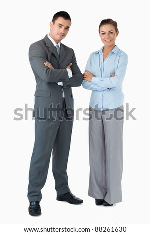 Confident business partner with arms folded against a whit background - stock photo