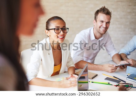 Confident business partners interacting at meeting - stock photo