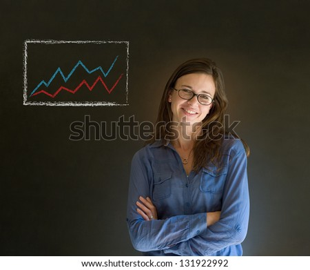 Confident business woman against a dark blackboard background with graph or chart - stock photo