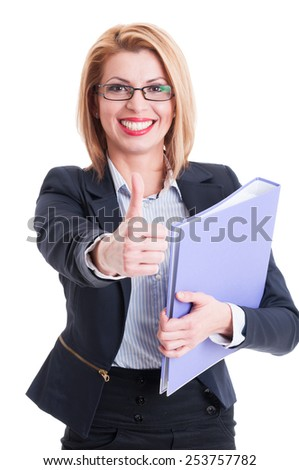 Confident business woman holding folder and showing thumbs up - stock photo