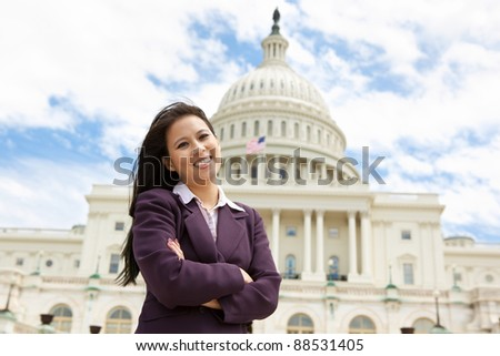 Confident business woman in front of United States capitol building in Washington DC - stock photo