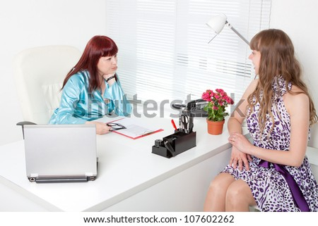 Confident business woman interviewing a young girl - stock photo