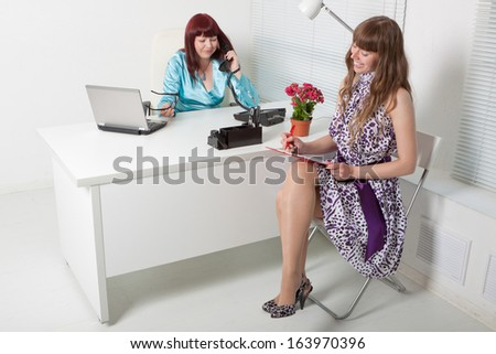 Confident business woman interviewing a young smiling girl - stock photo