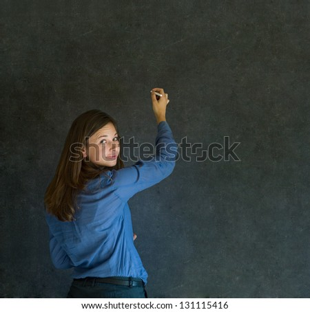 Confident business woman or teacher writing on dark blackboard background