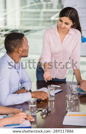 Confident business woman presenting new business strategy at conference room to partners. - stock photo