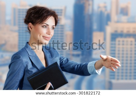 Confident business woman pulls her hand for a handshake, executive manager on negotiations, making great deal, lifestyle of successful people - stock photo