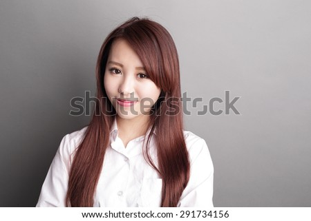 confident business woman smile to you isolated over gray background, asian beauty - stock photo