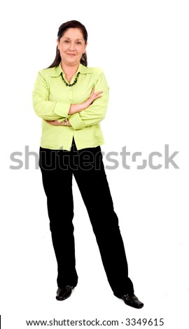 confident business woman standing wearing elegant casual clothes including black trousers and a green top - isolated over a white background - stock photo
