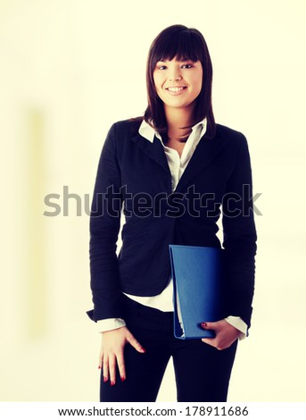 Confident business woman standing wearing elegant clothes - stock photo