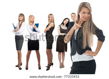 Confident business woman with colleagues standing in the background. Isolated on white - stock photo