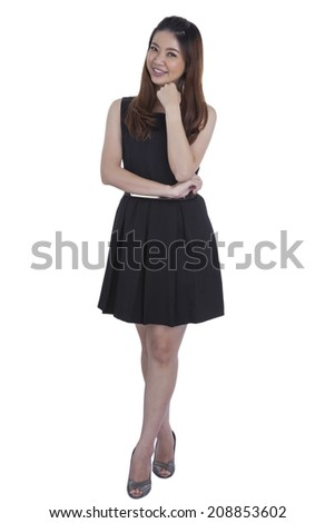 Confident business xwoman standing full length in black suit. Businesswoman or real estate agent isolated on white background. - stock photo