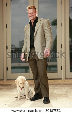 Confident businessman and his pet - stock photo