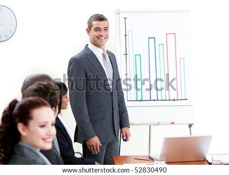 Confident businessman doing a presentation to his team - stock photo