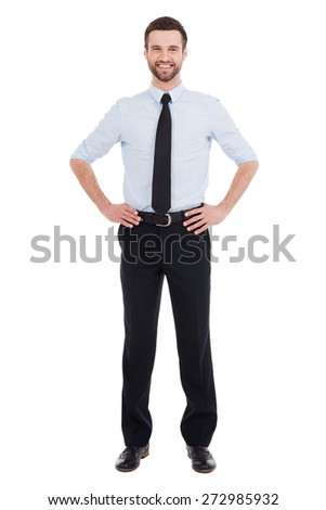 Confident businessman. Full length of confident young businessman in shirt and tie looking at camera and smiling while standing against white background - stock photo