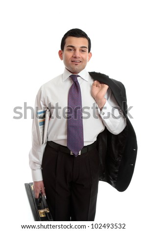 Confident businessman holding a briefcase in one hand, newspaper underarm and suit jacket slung over other  shoulder - stock photo