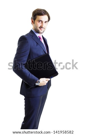 Confident businessman holding a laptop, isolated on white, dark suit, positive attitude. - stock photo