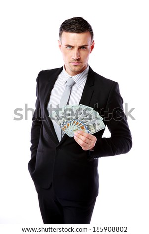 Confident businessman holding US dollars isolated on a white background - stock photo