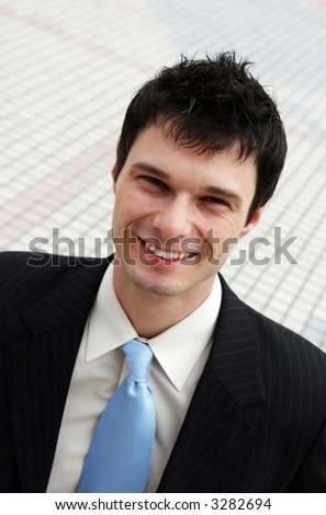 Confident businessman in a suit and tie - stock photo