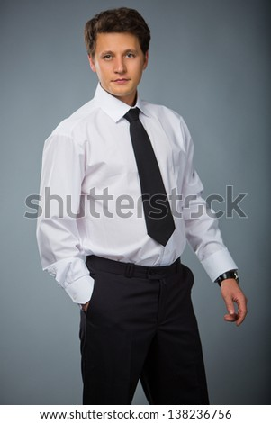 confident businessman in white shirt and tie - stock photo