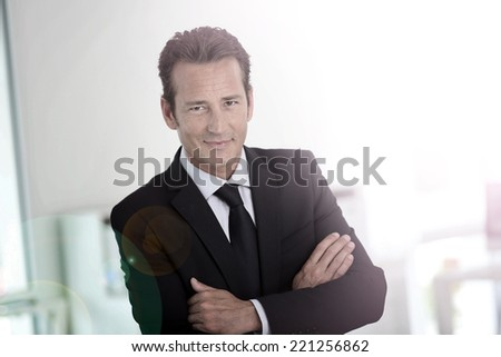 Confident businessman looking at camera - stock photo