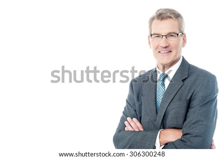 Confident businessman posing with folded arms