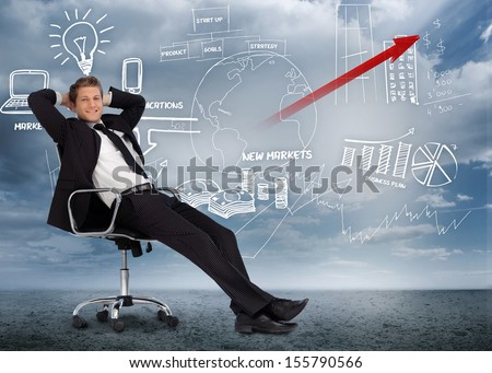 Confident businessman reclining in swivel chair in front of marketing flowchart in desert landscape - stock photo