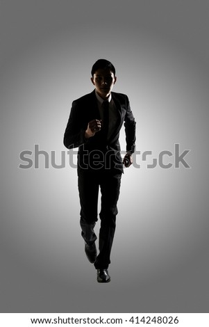 Confident businessman running, silhouette portrait isolated - stock photo