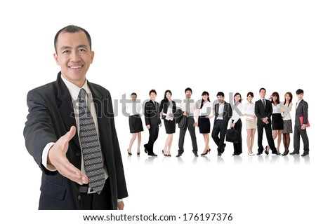 Confident businessman shake hand with you and standing in front of his team on studio white background. - stock photo