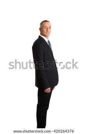 Confident businessman standing - stock photo