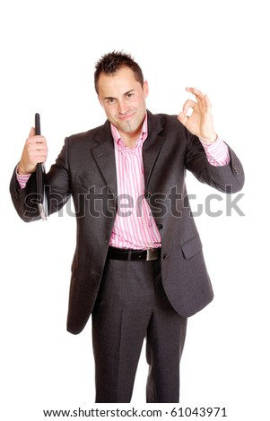 Confident businessman standing with notebook - stock photo