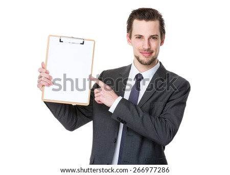 Confident businessman with clipboard - stock photo