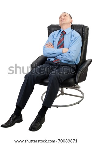 Confident businessman with crossed arms sitting in armchair and relaxing, isolated on white - stock photo