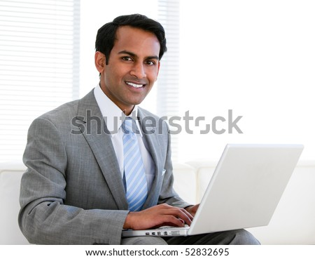 Confident businessman working on his computer in the office - stock photo