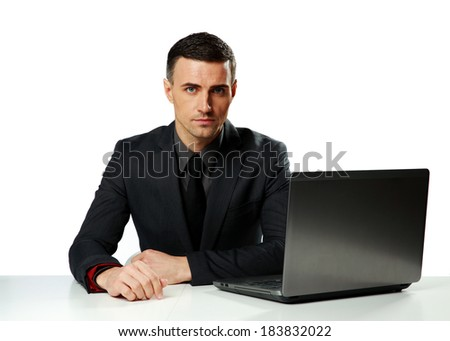 Confident businessman working on laptop isolated on a white background - stock photo