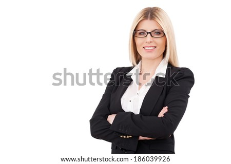Confident businesswoman. Confident mature businesswoman keeping arms crossed and smiling while standing isolated on white - stock photo