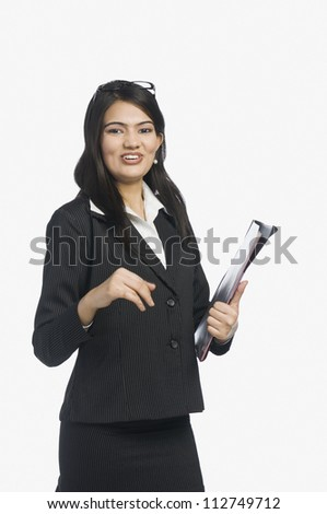 Confident businesswoman holding notes