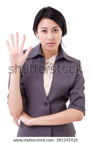 confident businesswoman pointing up 5 fingers gesture - stock photo