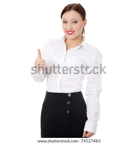 Confident businesswoman standing wearing elegant clothes with thumb up