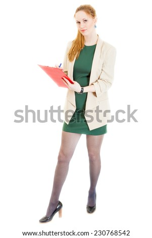 confident businesswoman wearing a green dress, jacket, black panti-tights and sandals stands with documents - stock photo