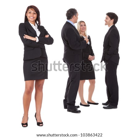 Confident businesswoman with successful group of business people on white background