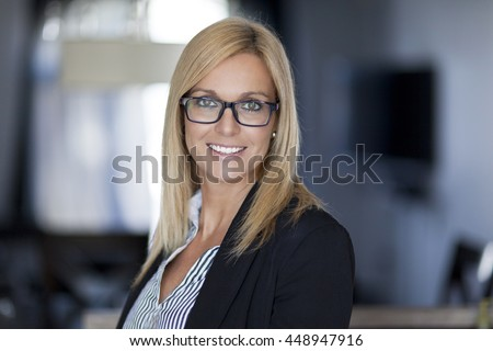 Confident Businesswoman Working At The Office - stock photo