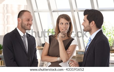 Confident caucasian business team meeting at office. Wearing suit, smiling, bristly. - stock photo