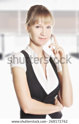 Confident caucasian woman on phone at office against window - stock photo