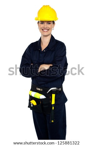 Confident cheerful female architect with tool kit around her waist. - stock photo
